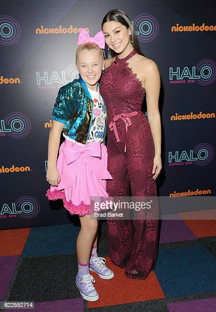 JoJo Siwa and Kira Kosarin pose backstage during the 2016 Nickelodeon HALO awards at Basketball City Pier 36 South Street on November 11 2016 in New...