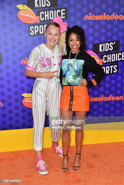 JoJo Siwa and Liza Koshy attend the Nickelodeon Kids' Choice Sports 2018 at Barker Hangar on July 19 2018 in Santa Monica California