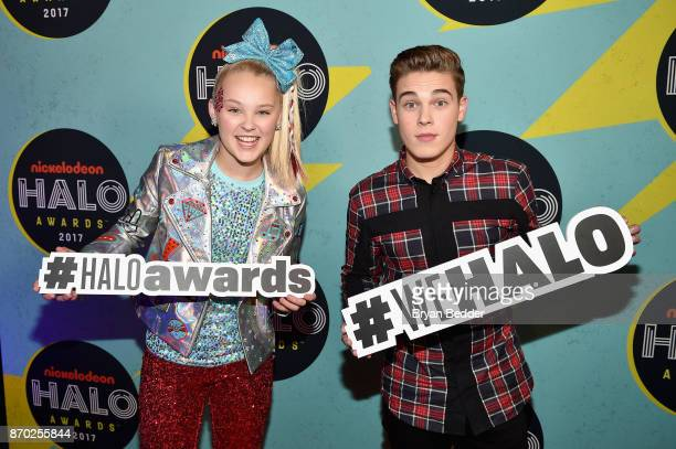 Jojo Siwa and Ricardo Hurtado pose backstage at the 2017 Nickelodeon HALO Awards at Pier 36 on November 4 2017 in New York City