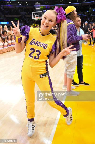 JoJo Siwa attends a basketball game between the Los Angeles Lakers and the Sacramento Kings at Staples Center on March 24, 2019 in Los Angeles,...