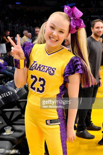 JoJo Siwa attends a basketball game between the Los Angeles Lakers and the Sacramento Kings at Staples Center on March 24 2019 in Los Angeles...
