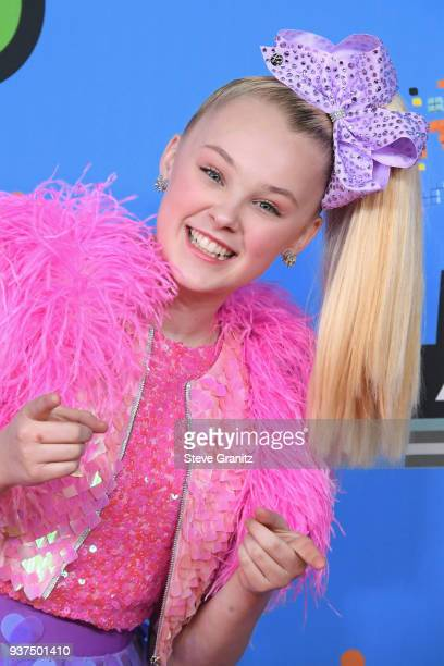 JoJo Siwa attends Nickelodeon's 2018 Kids' Choice Awards at The Forum on March 24, 2018 in Inglewood, California.