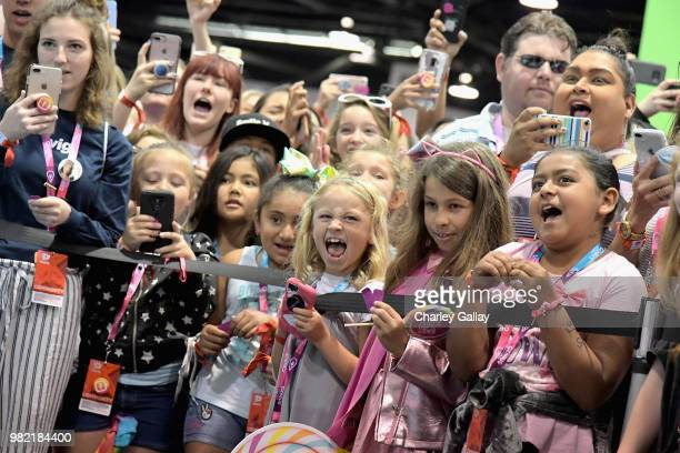 JoJo Siwa fans at Nickelodeon's booth at 2018 VidCon at Anaheim Convention Center on June 23 2018 in Anaheim California