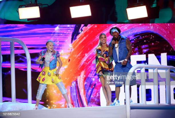 JoJo Siwa Lele Pons and Nick Cannon speak onstage during FOX's Teen Choice Awards at The Forum on August 12 2018 in Inglewood California
