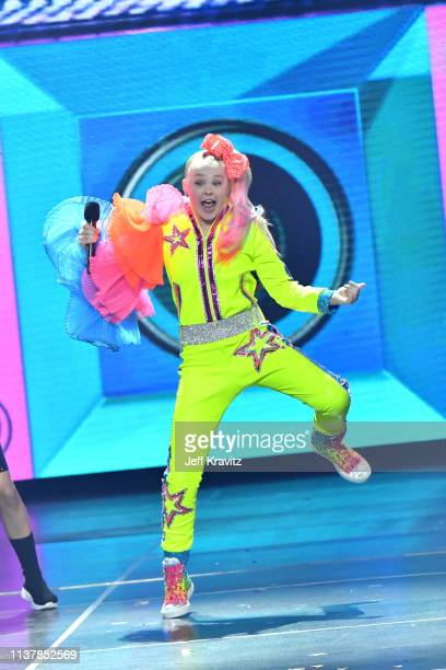 JoJo Siwa performs onstage at Nickelodeon's 2019 Kids' Choice Awards at Galen Center on March 23 2019 in Los Angeles California