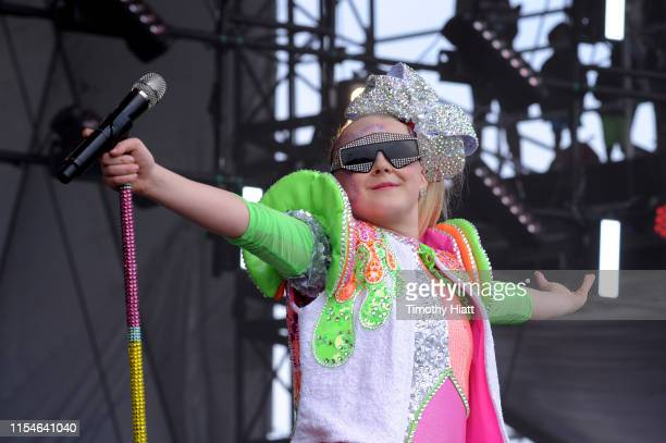 JoJo Siwa performs onstage during Nickelodeon's Second Annual SlimeFest at Huntington Bank Pavilion on June 08, 2019 in Chicago, Illinois.