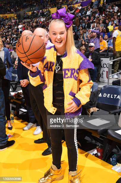 Jojo Siwa poses for a photo during the game between the Los Angeles Lakers and the Phoenix Suns on February 10, 2020 at STAPLES Center in Los...