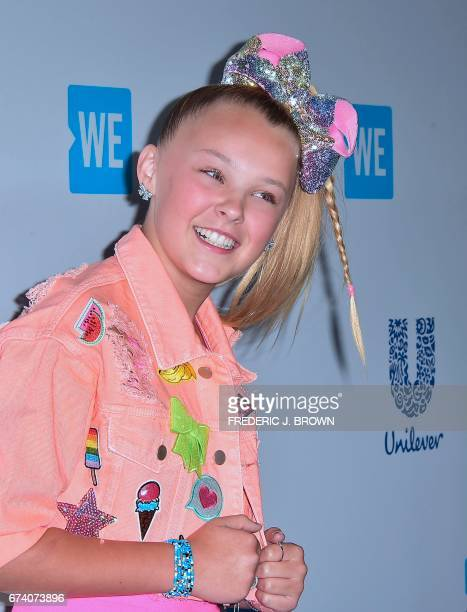 Jojo Siwa poses on arrival at We Day 2017 in Inglewood California on April 27 2017 WE Day California is a celebritystudded educational event that...