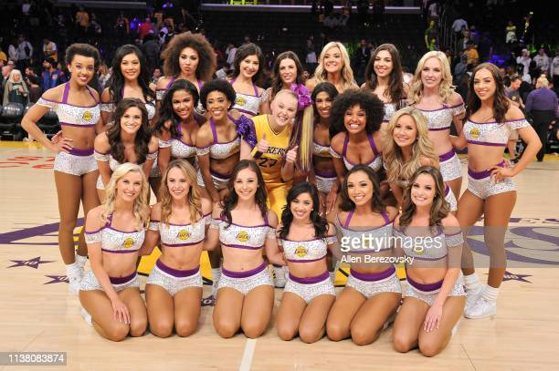 JoJo Siwa poses with Laker Girls after a basketball game between the Los Angeles Lakers and the Sacramento Kings at Staples Center on March 24 2019...