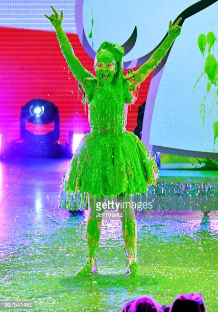 JoJo Siwa reacts after getting 'slimed' onstage at Nickelodeon's 2018 Kids' Choice Awards at The Forum on March 24, 2018 in Inglewood, California.