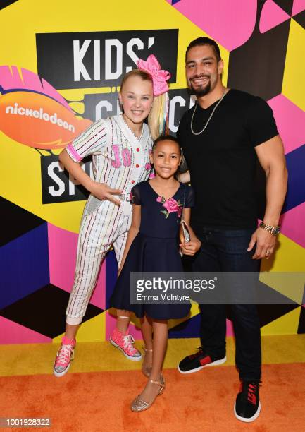 JoJo Siwa wrestler Roman Reigns and daughter JoJo Anoa'i attend the Nickelodeon Kids' Choice Sports 2018 at Barker Hangar on July 19 2018 in Santa...