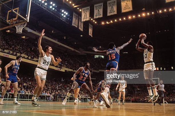 JoJo White of the Boston Celtics shoots a jump shot against Earl Monroe of the New York Knicks during a game played in 1972 at the Boston Garden in...