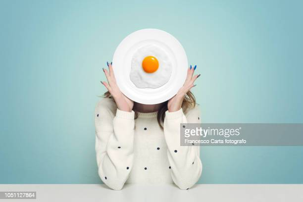 joke at the table - fried eggs stock pictures, royalty-free photos & images