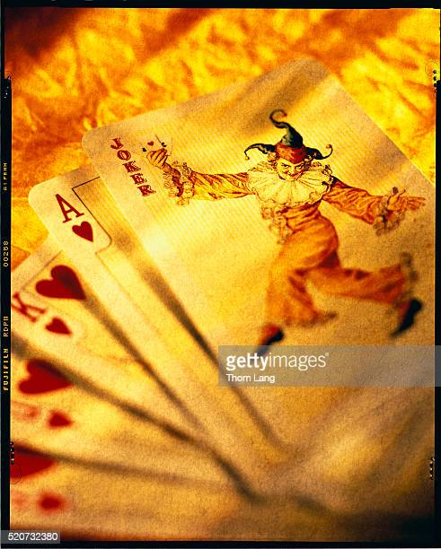 joker of vintage playing cards - royal flush stock photos and pictures