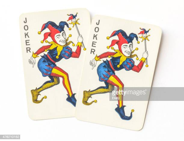 joker on vintage playing cards. - joker card stock photos and pictures