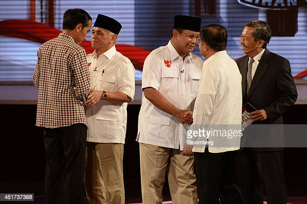 Joko Widodo, governor of Jakarta and presidential candidate, left, shakes hands with Hatta Rajasa, vice presidential candidate and the running mate...