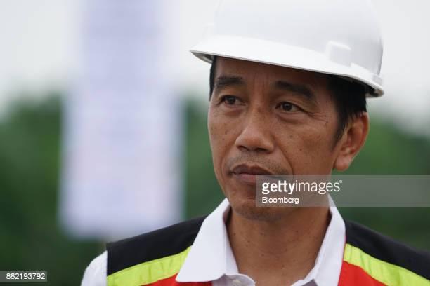 Joko Widodo Indonesia's president attends the inauguration of the MedanKualanamuTebing Tinggi toll road in Medan North Sumatra Indonesia on Friday...