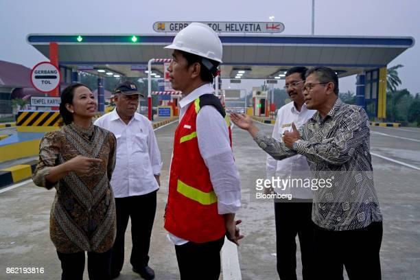 Joko Widodo Indonesia's president center is briefed by Rini Soemarno Indonesia's minister of stateowned enterprises from left Basuki Hadimuljono...