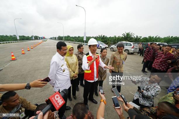 Joko Widodo Indonesia's president center speaks to members of the media during the inauguration of the MedanKualanamuTebing Tinggi toll road in Medan...