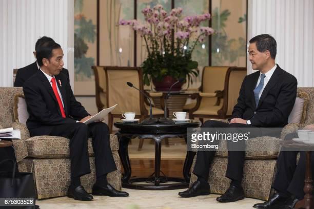 Joko Widodo Indonesia's president left speaks to Leung Chunying Hong Kong's chief executive during a meeting in Hong Kong China on Monday May 1 2017...