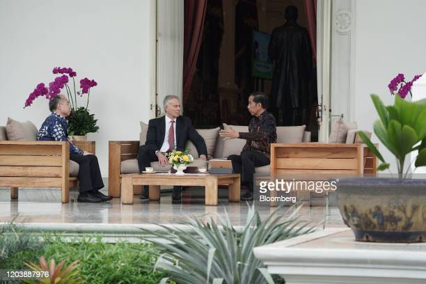 Joko Widodo Indonesia's president right speaks with Tony Blair UK's former prime minster center and Masayoshi Son chairman and chief executive...