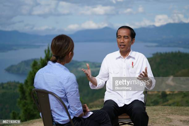 Joko Widodo Indonesia's president speaks during a Bloomberg Television interview in front of Lake Toba in Silangit North Sumatra Indonesia on...