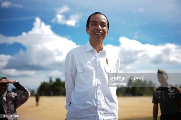 Joko Widodo Indonesia's president stands ahead of a Bloomberg Television interview in Silangit North Sumatra Indonesia on Saturday Oct 14 2017...