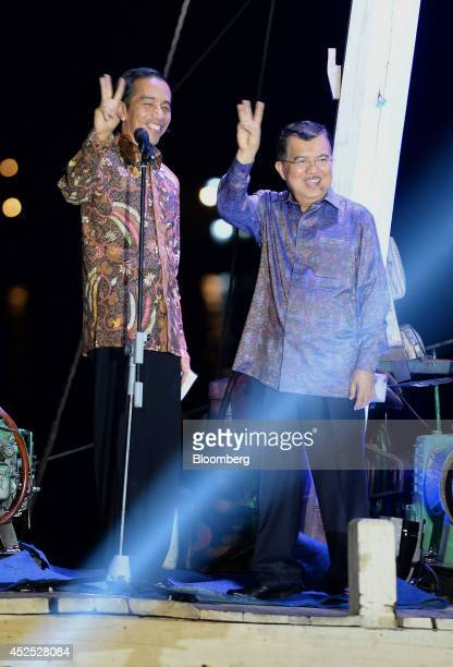 Joko Widodo, Indonesia's president-elect, left, and Vice President Jusuf Kalla gesture to supporters and media during a victory speech in Jakarta,...