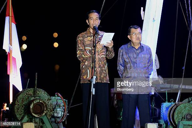 Joko Widodo, Indonesia's president-elect, left, delivers a victory speech with Vice President Jusuf Kalla to supporters and media in Jakarta,...