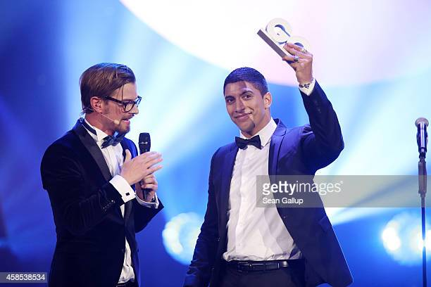 Joko Winterscheidt and Andreas Bourani are seen on stage at the GQ Men Of The Year Award 2014 at Komische Oper on November 6 2014 in Berlin Germany