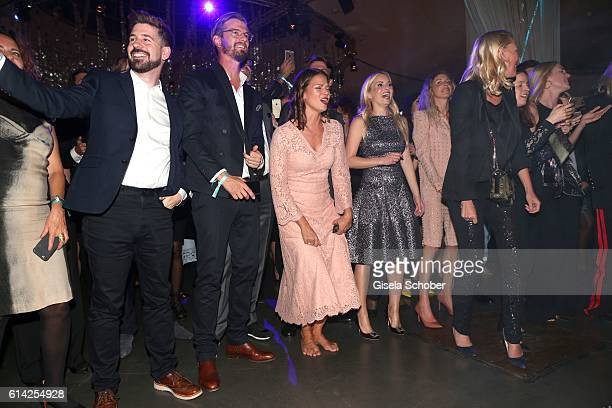 Joko Winterscheidt and Jessica Schwarz barefoot and Delia Fischer CEO and Founder of Westwing during the 5th anniversary of Westwing on October 12...