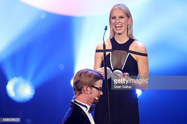 Joko Winterscheidt and Karolina Kurkova are seen on stage at the GQ Men Of The Year Award 2014 at Komische Oper on November 6 2014 in Berlin Germany