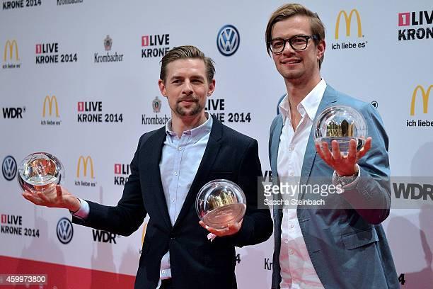 Joko Winterscheidt and Klaas HeuferUmlauf pose with the award during the 1Live Krone 2014 at Jahrhunderthalle on December 4 2014 in Bochum Germany