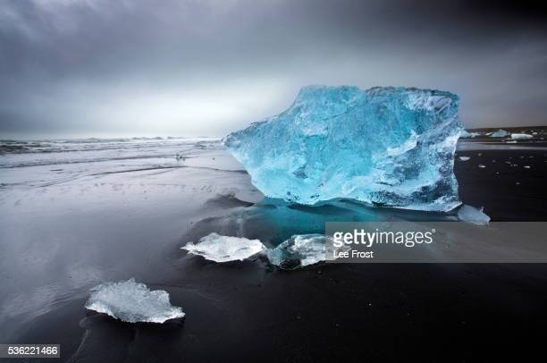 Jokulsa Beach on a stormy day, where icebergs from nearby Jokulsarlon glacial lagoon flow into the North Atlantic and are then washed back onto the black volcanic sand beach, on the edge of the Vatnajokull National Park, South Iceland, Iceland, Polar