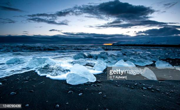 jokulsarlon  black volcanic sandy beach and ice - arctic stock pictures, royalty-free photos & images