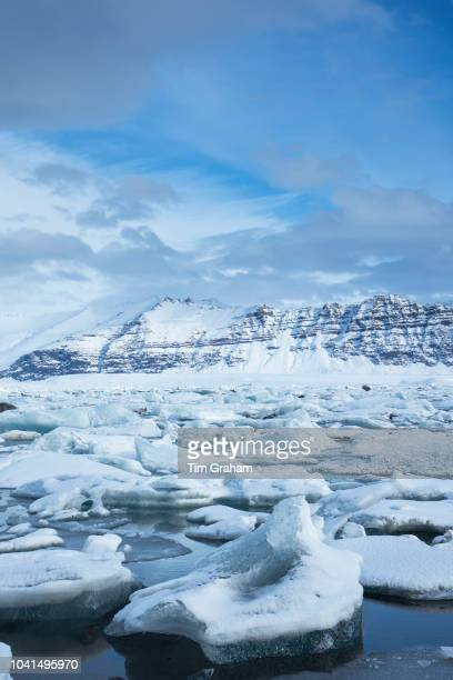 Jokulsarlon glacial lagoon by Vatnajokull National Park. Floating icebergs in blue water from Breioamerkurjokull Glacier, part of Vatnajokull Glacier...