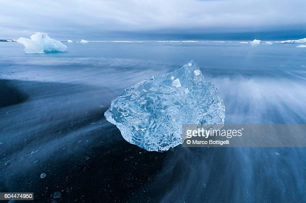 Jokulsarlon glacier lagoon, Iceland. Blocks of ice ashore over the black sand beach.