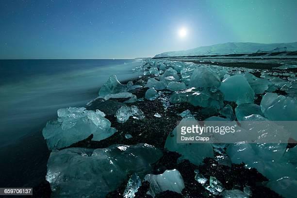Jokulsarlon in moonlight with aurora in Iceland
