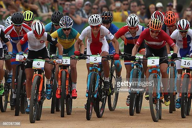 Jolanda Neff of Poland, Maja Wloszczowska of Poland and Annika Langvad of Denmark lead a group during the Women's Cross-Country Mountain Bike Race on...