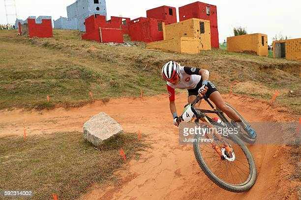 Jolanda Neff of Poland races during the Women's Cross-Country Mountain Bike Race on Day 15 of the Rio 2016 Olympic Games at the Mountain Bike Centre...