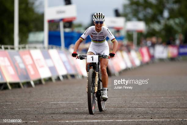 Jolanda Neff of Switzerland reacts when approaching the finish line and winning the race during the Women's Mountain Bike CrossCountry on Day Six of...