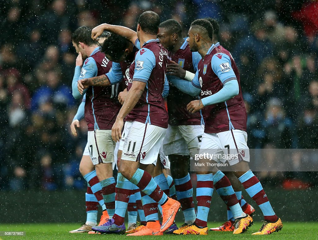 Joleon Lescott (2nd L) of Aston Villa celebrates scoring his team's first goal with his team mates during the Barclays Premier League match between Aston Villa and Norwich City at Villa Park on February 6, 2016 in Birmingham, England.