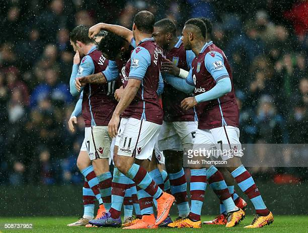 Joleon Lescott of Aston Villa celebrates scoring his team's first goal with his team mates during the Barclays Premier League match between Aston...