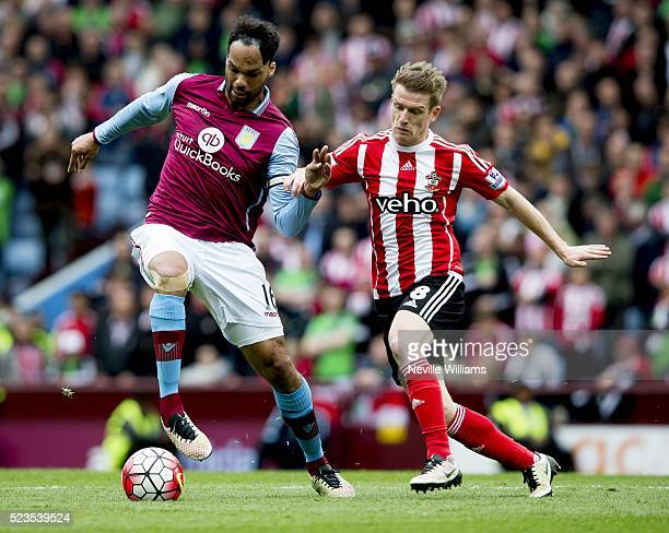 Joleon Lescott of Aston Villa is challenged by Steven Davis of Southampton during the Barclays Premier League match between Aston Villa v Southampton...
