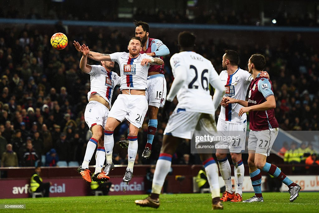 Joleon Lescott of Aston Villa (16) outjumps the Crystal Palace defence to score their first goal with a header during the Barclays Premier League match between Aston Villa and Crystal Palace at Villa Park on January 12, 2016 in Birmingham, England.