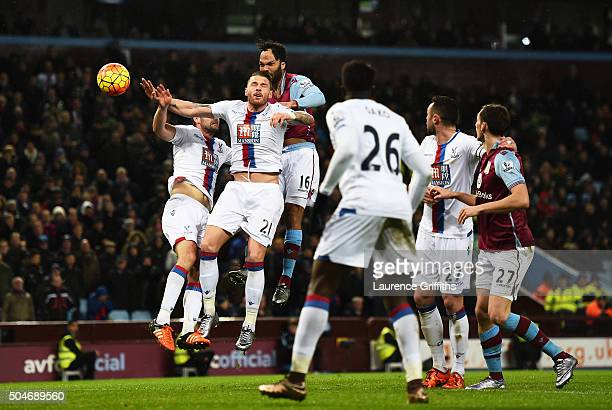Joleon Lescott of Aston Villa outjumps the Crystal Palace defence to score their first goal with a header during the Barclays Premier League match...