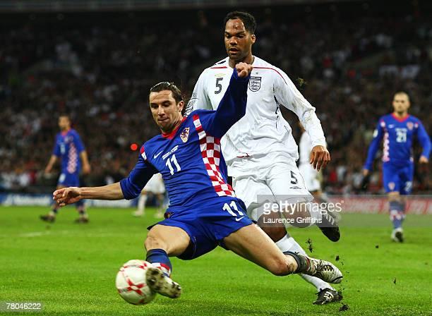 Joleon Lescott of England challenges Darijo Srna of Croatia during the Euro 2008 Group E qualifying match between England and Croatia at Wembley...