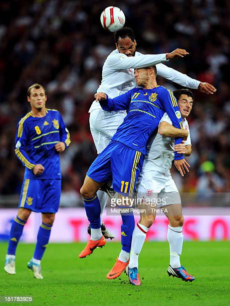Joleon Lescott of England rises above Andrii Iarmolenko of Ukraine to win a header during the FIFA 2014 World Cup qualifier group H match between...