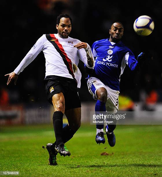 Joleon Lescott of Manchester City and Darius Vassell of Leicester City challenge for the ball during the FA Cup sponsored by EON 3rd Round match...