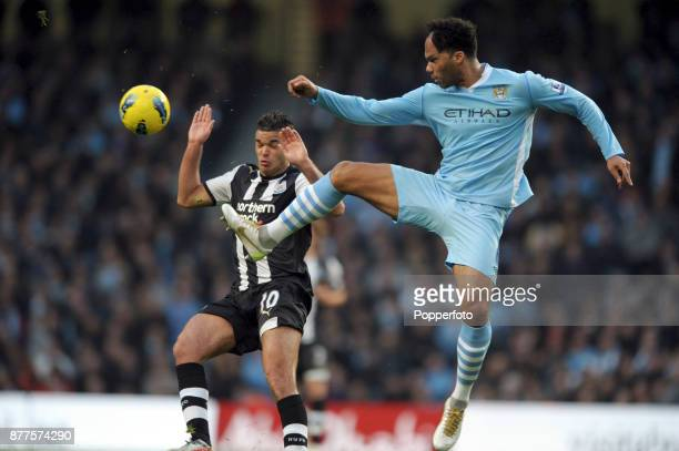 Joleon Lescott of Manchester City and Hatem Ben Arfa of Newcastle United challenge for the ball during a Barclays Premier League match at the Etihad...